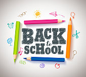 Back to school vector typography banner design with colorful crayons