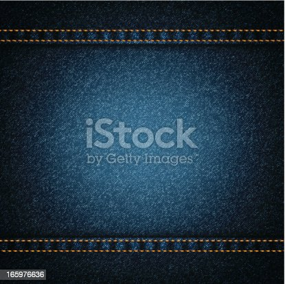 istock Background of dark blue denim with orange threading 165976636