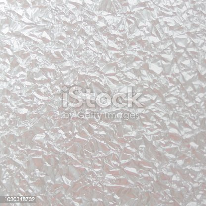 Background texture of crumpled foil sheet. Light Abstract silver background. Vector illustration.