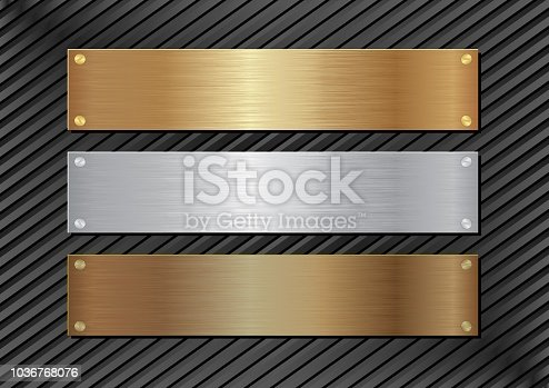 three metal plaques on black background