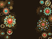 dark background is decorated with jewelery, gold and bronze ornaments in ethnic style with turquoise and jasper. Jewelery in boho style.