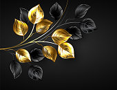 Black background with gold and black twigs, decorated with gold foil leaves.