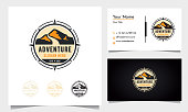 istock badge adventure logo design with mountains and road with compass ornament 1265124081