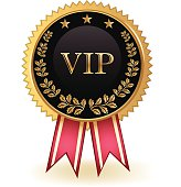 Gold, ornate VIPexclusive badge with a decorative ribbon.