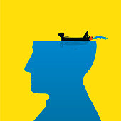 A man in a boat bails out water from the silhouette of a head