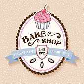 Cute bakery or cafe sign with cucpake, ribbon banner and text. Created in CMYK. Comes with a large high resolution jpeg.
