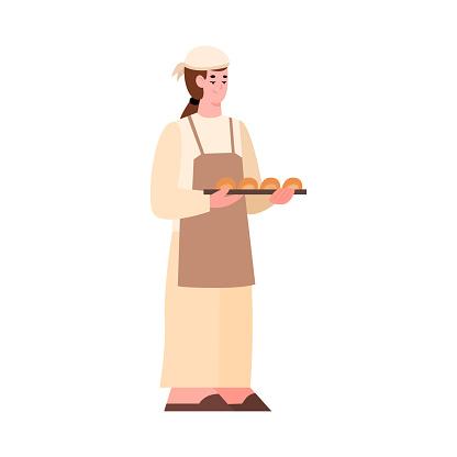Baker holding fresh baked bread