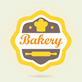 Bakery badge or label in old or vintage style. Design elements with bread symbol isolated on white background. Colorful vector illustration.