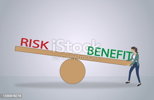 istock Balance with risk benefit, pros and cons. 1255976279