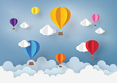 Ballon and Cloud in the  blue sky with paper art design , vector design element  and illustration