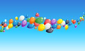 Vector illustration of colorful balloons flying horizontally.