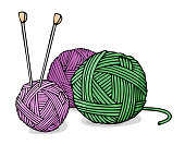Balls of wool for knitting green and purple colors and knitting needles.