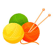 Balls of yarn with knitting needles. Clews, skeins of wool. Tools for handicraft, hand-knitting.