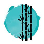 Bamboo trees black silhouettes and blue watercolor circle paint stain isolated on white background - vector artwork