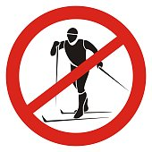 Ban skiing, black silhouette of man at red circle frame, vector road sign on white background.