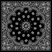 Black bandana with white ornaments.