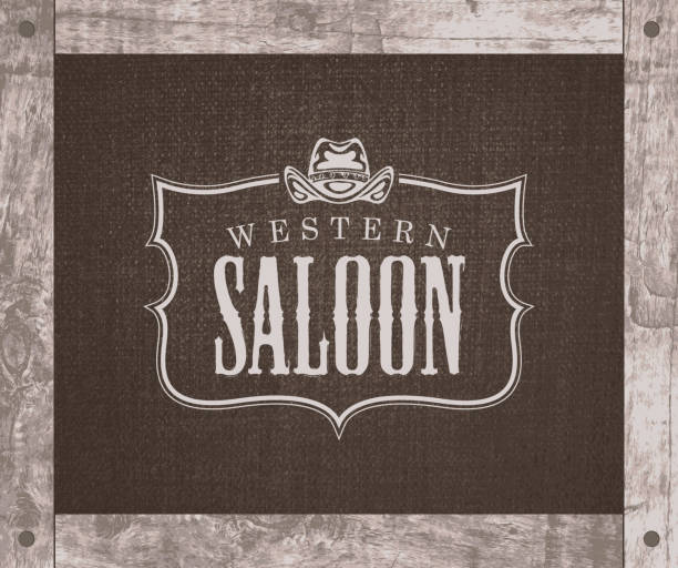 banner with cowboy hat and words Western saloon Vector banner on the theme of the Wild West with a cowboy hat and the words Western saloon. Decorative illustration with the  of the Western saloon on a background of burlap in a wooden frame southern usa stock illustrations