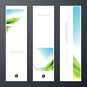 Set of three vertical banner templates with an abstract background. Blurred landscape, blue sky, nature, sea, with bright colors.