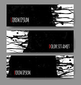 Banners with black grunge splashes on realistic paper background.