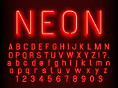 istock Bar or Casino glowing sign elements. Red neon letters and numbers with fluorescent light vector illustration 984077726