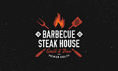 istock Barbecue, Steak House restaurant logo, poster. BBQ grill logo with fire flame, spatula and grill fork. Vector emblem template. 1264360604