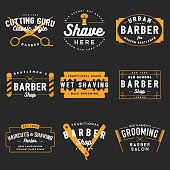 100% Vector set of vintage barber shop emblems.