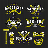 A set of Barbershop vintage emblems isolated on black background. Vector illustration, global colours easy to edit, all objects grouped and layered.