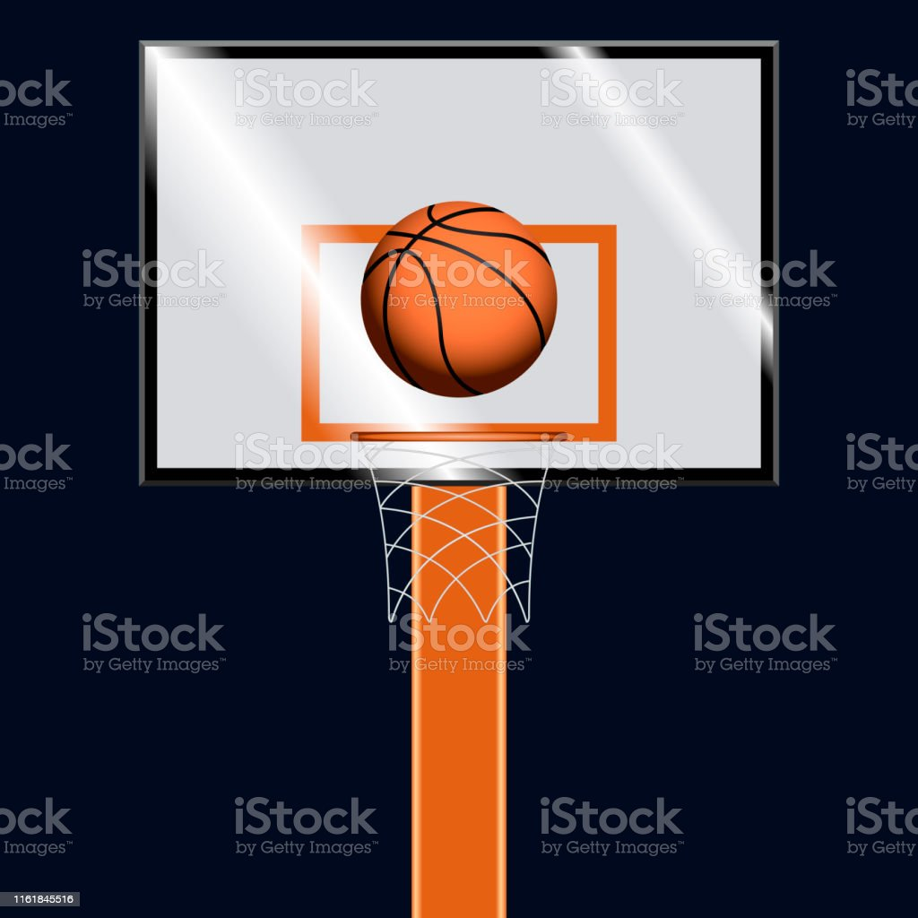 Basketball ball on a basketball hoop over a dark colored background -...