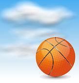 Basketball Ball on Cloudy Sky Background