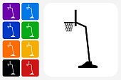 Basketball Hoop Icon Square Button Set. The icon is in black on a white square with rounded corners. The are eight alternative button options on the left in purple, blue, navy, green, orange, yellow, black and red colors. The icon is in white against these vibrant backgrounds. The illustration is flat and will work well both online and in print.