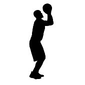 Basketball player shooting ball, side view. Isolated vector silhouette