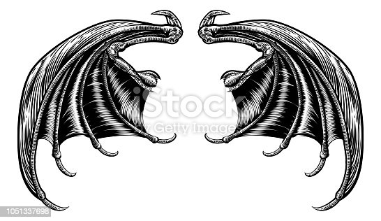 A set of dragon, bat or other scary wings in a retro woodcut engraving style