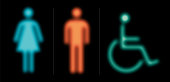 Bathroom icons for male, female and wheelchair in blue, orange and green on black background. This vector file is part of the 'neon half tone design set', playing with circular half tone raster imitating glow effects as known by neon lights.
