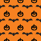 Vector seamless pattern of bats and jack o' lanterns on an orange background.