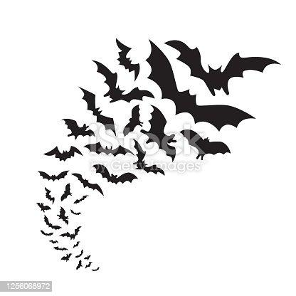 Flying bats group isolated on white background. Black night bat silhouettes