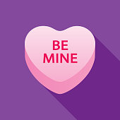 Vector illustration of a be mine pink candy valentine heart on a purple background.