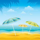 Beach background with blue sea, stripped beach chairs and beach umbrella.