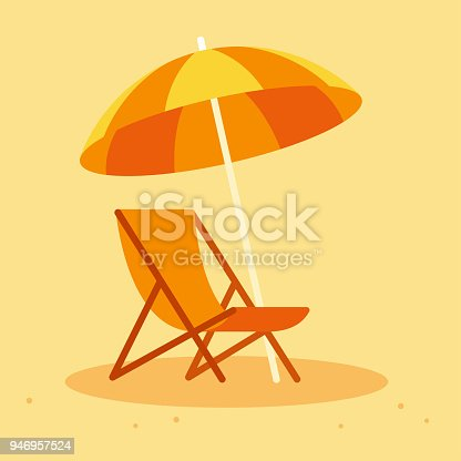 istock Beach chair and umbrella 946957524