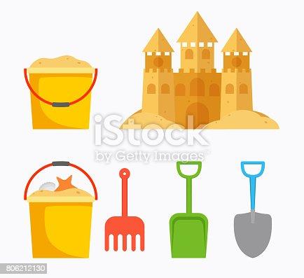 istock Beach sand castle with children's bucket, sand bucket, shovel, rake. Baby summer accessories for beach. 806212130