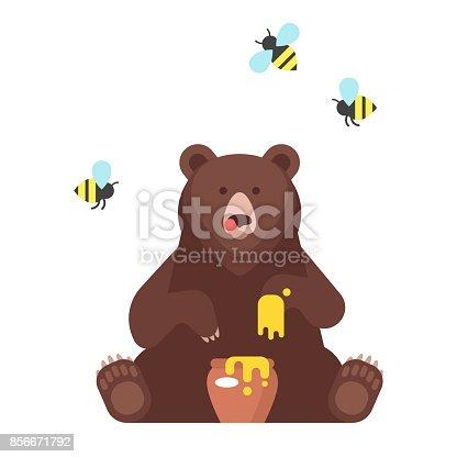 istock bear character eating sweet honey. 856671792