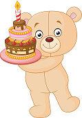 Bear holding birthday cake