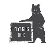 Bear holding signboard