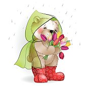 Bear with a bouquet of tulips standing in the rain1