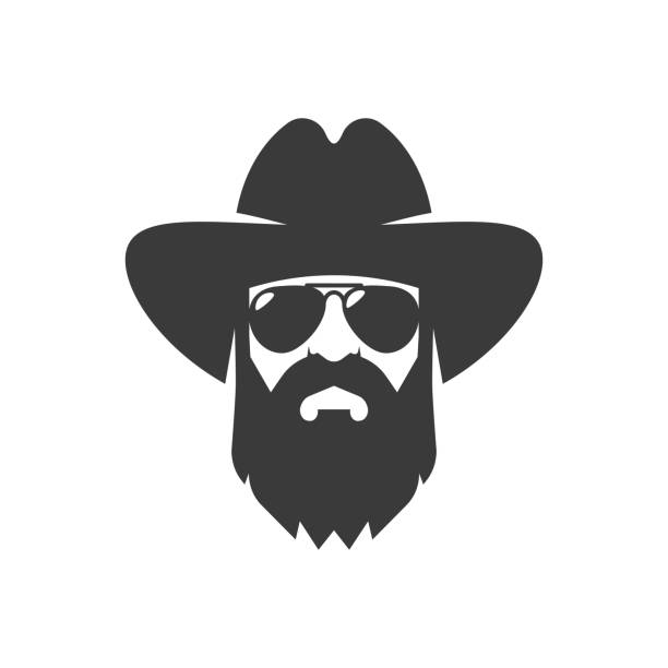 Bearded cowboy in sunglasses and in a hat. Cool American man Bearded cowboy in sunglasses and in a hat. Cool American man rancher illustrations stock illustrations