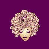Beautiful Afro American woman with elegant makeup, wearing a flower wig