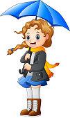 Beautiful autumn girl holding umbrella