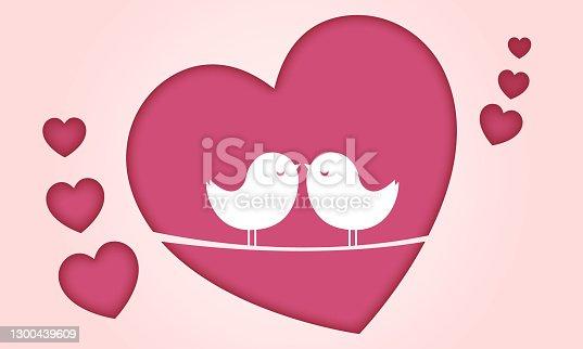 istock beautiful couple birds on pink hearts background 1300439609