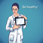 beautiful doctor with computer tablet medical apps