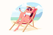 Beautiful girl in a swimming suit and hat sits on the beach in a sunbed and make selfie. Woman with smartphone relaxing on the beach. Summer vacation vector illustration. Flat style.
