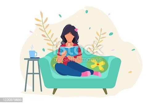Beautiful girl reading a book
